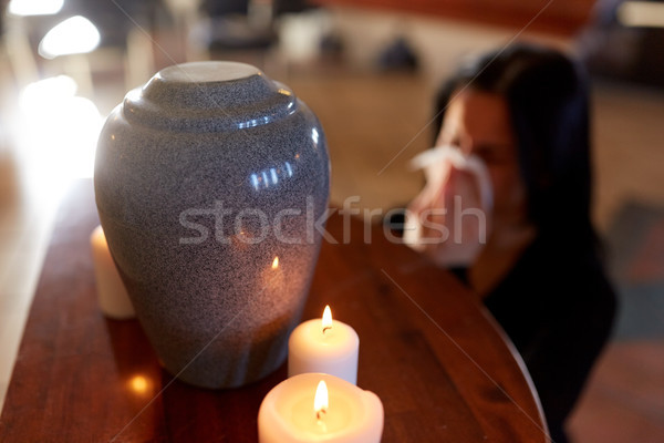 Stock photo: woman with cremation urn at funeral in church