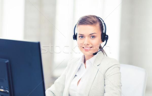 Amistoso femenino línea de ayuda operador Foto auriculares Foto stock © dolgachov