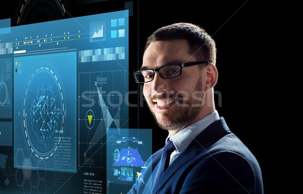 улыбаясь бизнесмен очки черный деловые люди технологий Сток-фото © dolgachov