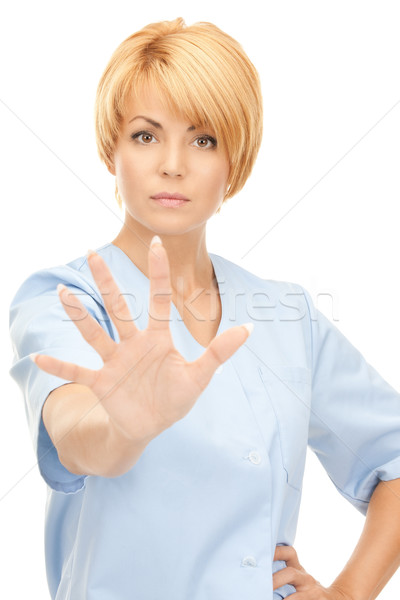 attractive female doctor showing stop gesture Stock photo © dolgachov