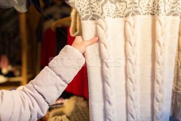 woman buying woolen clothes at christmas market Stock photo © dolgachov