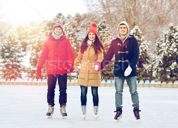 happy friends ice skating on rink outdoors Stock photo © dolgachov