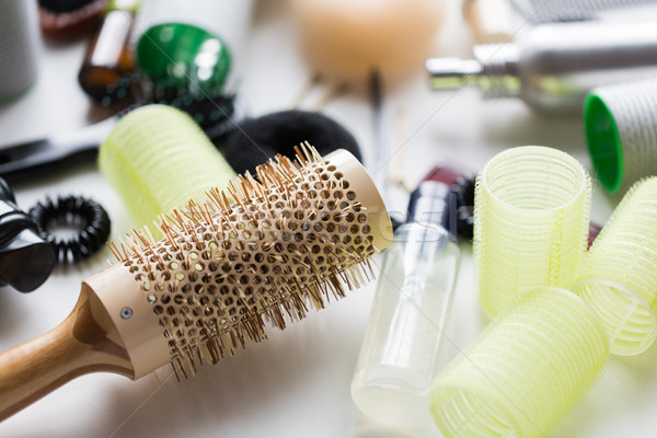 curling hair brush, styling spray and curlers Stock photo © dolgachov