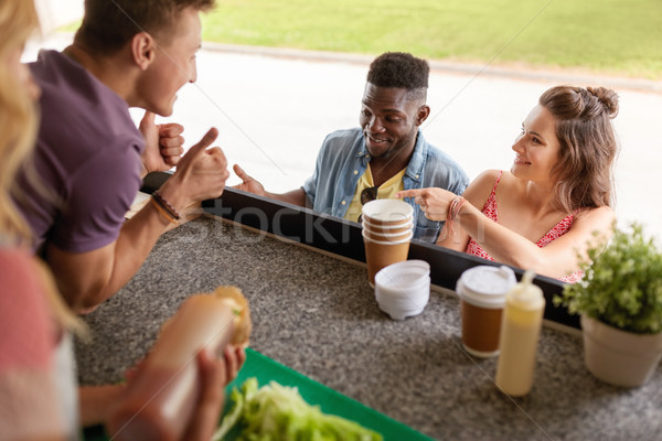 customers couple ordering something at food truck Stock photo © dolgachov