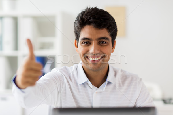 Stock photo: businessman showing thumbs up at office