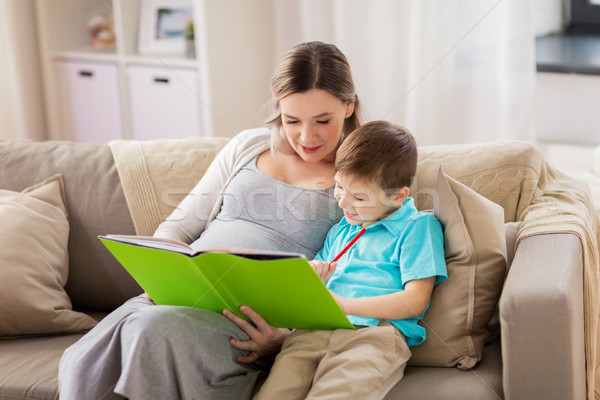 pregnant mother and little son with book at home Stock photo © dolgachov