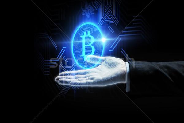 Imprenditore mano bitcoin simbolo finanziare Foto d'archivio © dolgachov