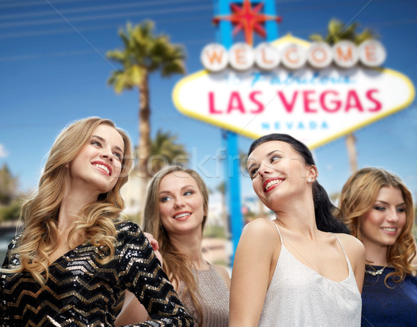 group of happy women or friends at las vegas party Stock photo © dolgachov