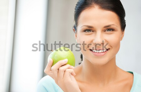 female hands with green apple Stock photo © dolgachov