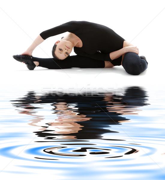 fitness in black leotard on white sand #3 Stock photo © dolgachov
