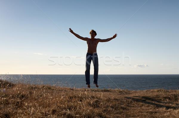 Levitatie geschikt man hemel sport haren Stockfoto © dolgachov