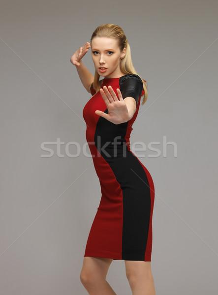 woman working with something imaginary Stock photo © dolgachov