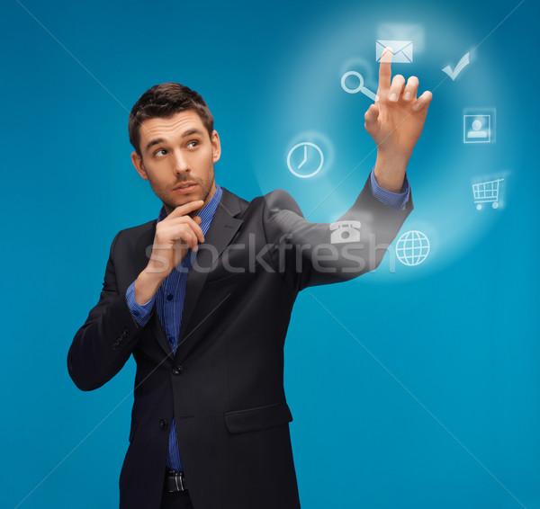 человека костюм рабочих что-то мнимый фотография Сток-фото © dolgachov
