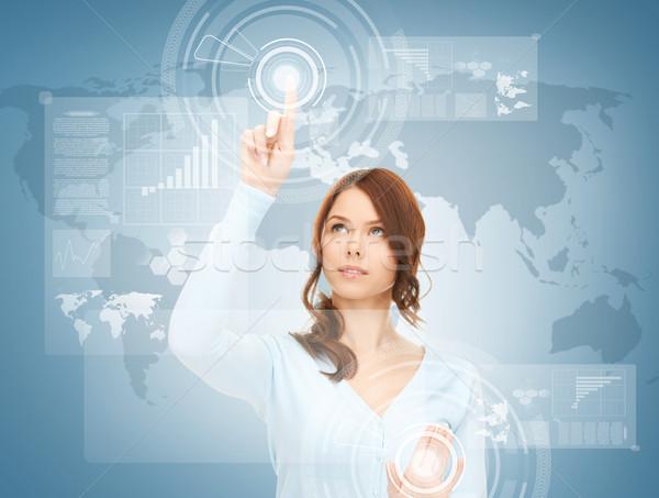 Stock photo: businesswoman touching virtual screen