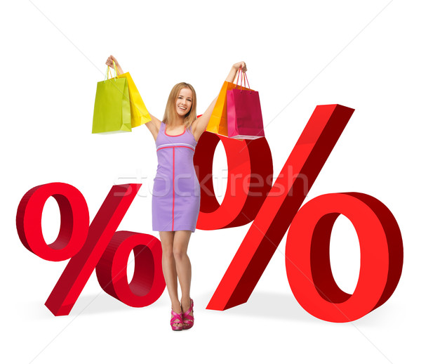 Stock photo: woman with shopping bags and percent signs