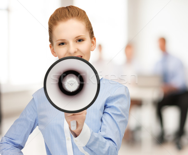 businesswoman with megaphone in office Stock photo © dolgachov