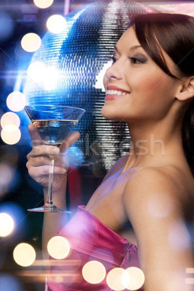 woman with cocktail and disco ball Stock photo © dolgachov