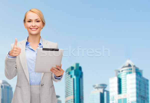 smiling woman with tablet pc showing thumbs up Stock photo © dolgachov