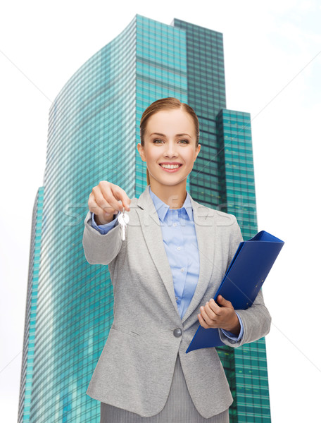 smiling businesswoman with folder and keys Stock photo © dolgachov