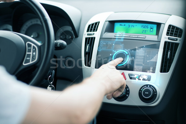 man using car control panel Stock photo © dolgachov