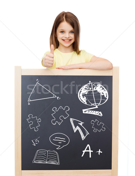 smiling girl with blackboard showing thumbs up Stock photo © dolgachov