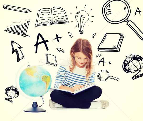 Lány földgömb könyv oktatás iskola kicsi Stock fotó © dolgachov