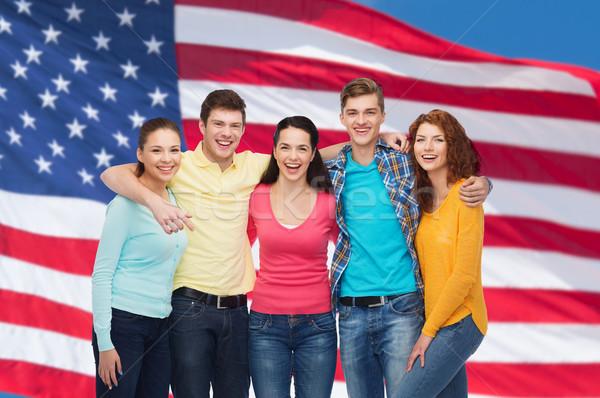 Groupe souriant adolescents drapeau américain amitié personnes Photo stock © dolgachov