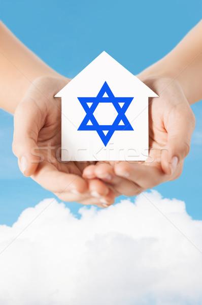 Handen huis star godsdienst Stockfoto © dolgachov