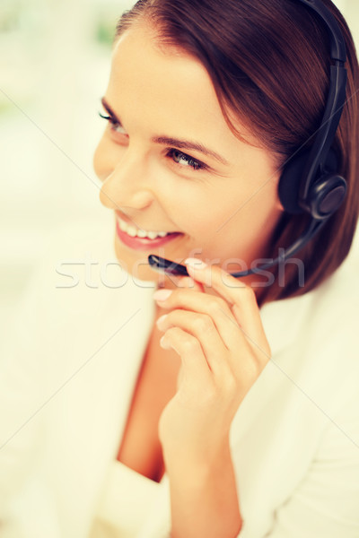 female helpline operator with headphones Stock photo © dolgachov