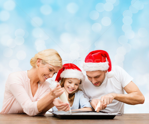 happy family in santa helper hats cooking Stock photo © dolgachov