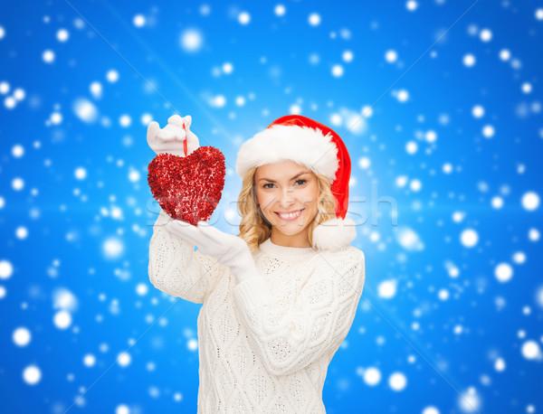 Mosolygó nő mikulás segítő kalap piros szív Stock fotó © dolgachov