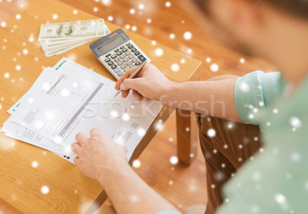 close up of man counting money and making notes Stock photo © dolgachov
