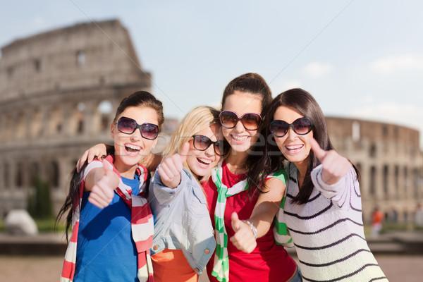 happy teenage girls or women showing thumbs up Stock photo © dolgachov