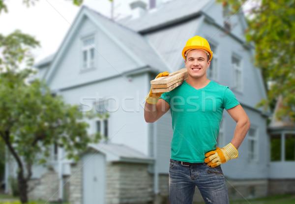 Sonriendo manual trabajador casco reparación Foto stock © dolgachov