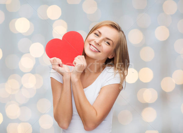 smiling woman in white t-shirt holding red heart Stock photo © dolgachov