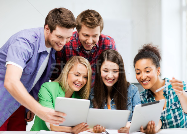 students looking at tablet pc in lecture at school Stock photo © dolgachov