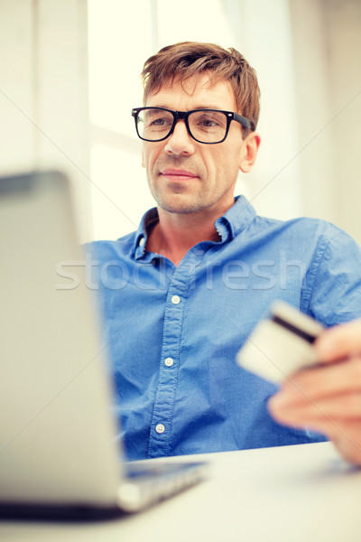 man with laptop and credit card at home Stock photo © dolgachov
