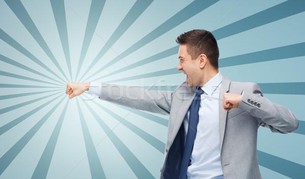 бизнесмен костюм кто-то деловые люди конфликт Сток-фото © dolgachov