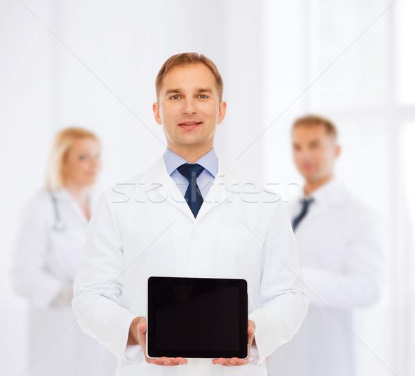 Foto stock: Sonriendo · doctor · de · sexo · masculino · medicina · anuncio · trabajo · en · equipo