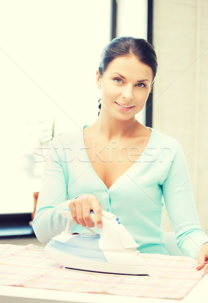 housewife ironing clothes Stock photo © dolgachov