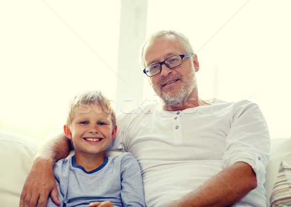 smiling grandfather and grandson at home Stock photo © dolgachov