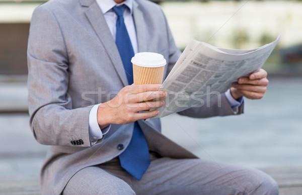 close up of businessman reading newspaper Stock photo © dolgachov