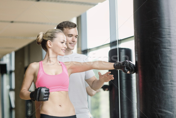 Gülümseyen kadın personal trainer boks spor salonu spor uygunluk Stok fotoğraf © dolgachov