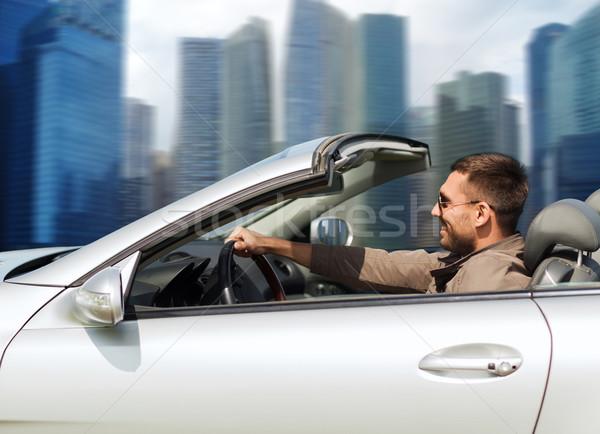 Felice uomo guida cabriolet auto esterna Foto d'archivio © dolgachov