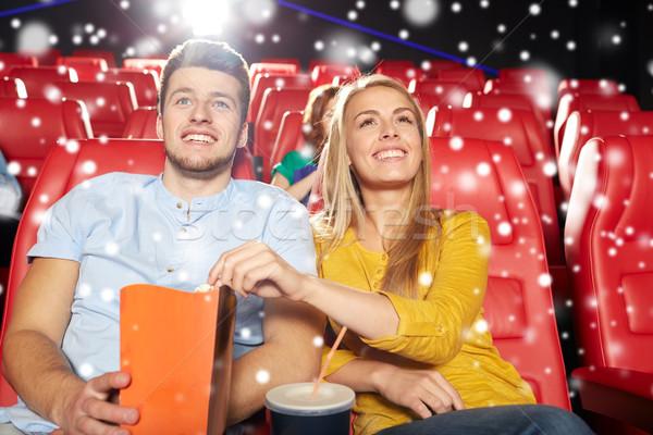 happy couple with popcorn and drink in cinema Stock photo © dolgachov