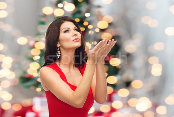 beautiful woman making christmas wish over lights Stock photo © dolgachov