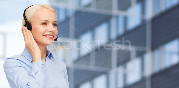 helpline operator in headset over business center Stock photo © dolgachov