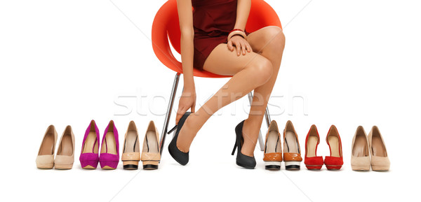 close up of woman trying on high heeled shoes Stock photo © dolgachov