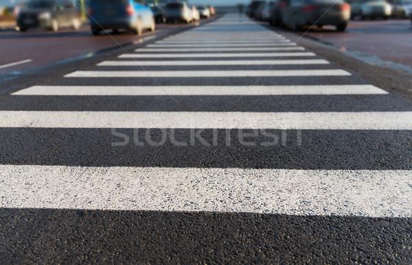 close up of pedestrian crosswalk on city parking Stock photo © dolgachov