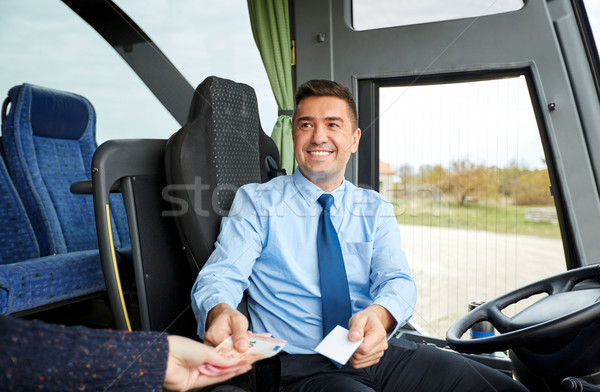 bus driver with money selling ticket to passenger Stock photo © dolgachov